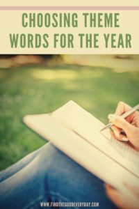 Choosing Theme Words for the Year Pinnable Image showing someone journaling outside
