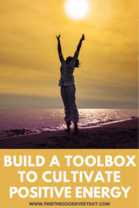 Build a Toolbox to Cultivate Positive Energy Pin with a photo of a person on a beach reaching up to the sun.