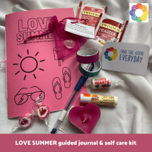 Photo showing the contents of the LOVE SUMMER guided journal and self care kit. Read on for the full list of contents.